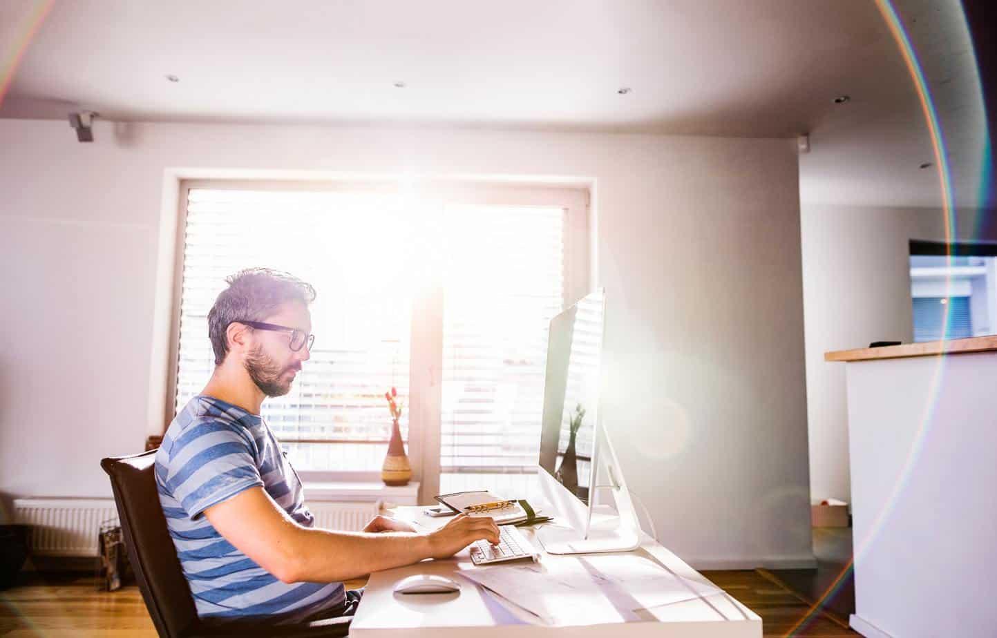 Hörz & Haapamäki man sitting at desk working from home on computer