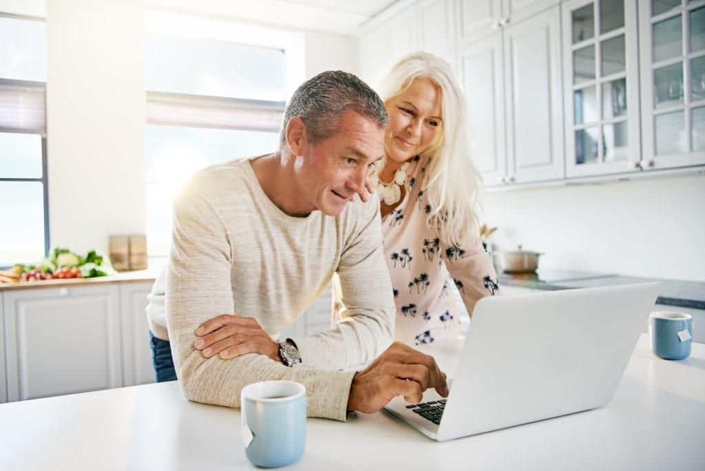 Hörz & Haapamäki elderly retired couple reading their social media