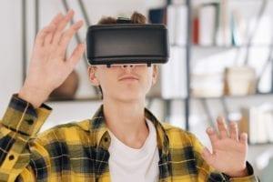 Teenager playing VR game