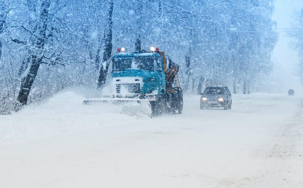 snow plow doing snow